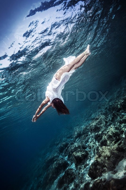 Happy Woman Diving To The Sea Bottom Swimming In Stylish White Dress Summertime Fashion