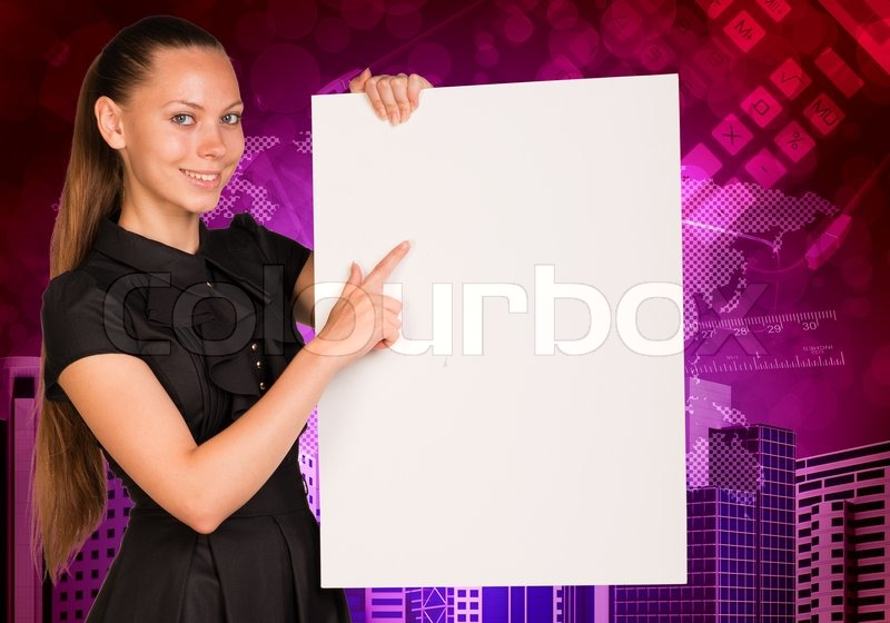 Beautiful businesswoman in dress smiling and holding empty paper sheet. Buildings and world map as backdrop, stock photo