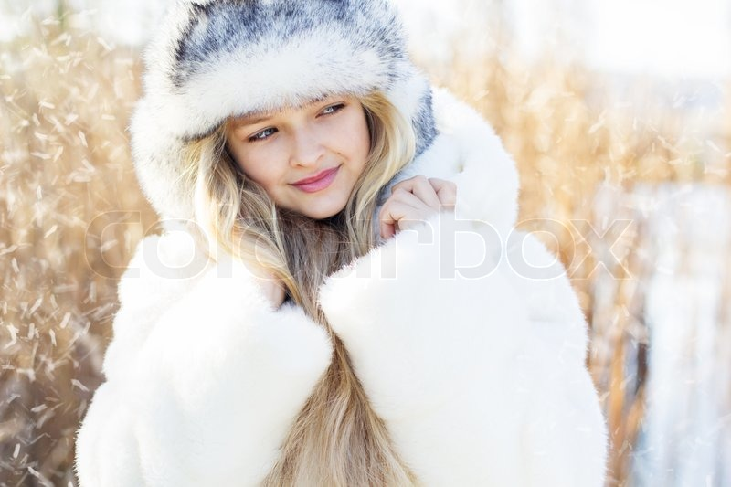 Winter Little Cute Girl Outdoors In Stock Photo
