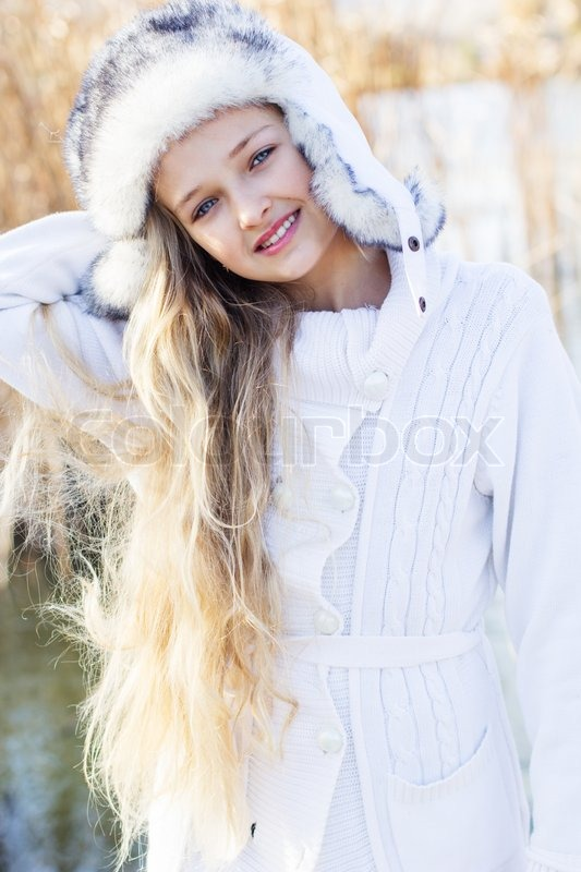 8814dc5cf Winter little cute girl outdoors is ...