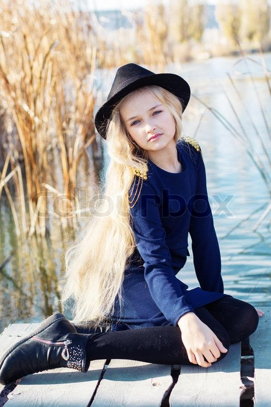 Dress portrait caucasian female blonde child model outside stock