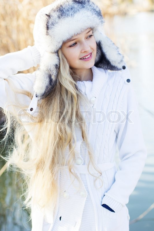 winter little cute girl outdoors in winter cold day
