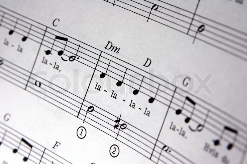Music notes in opened music note book, stock photo