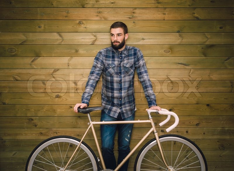 Hipster Man With His Fixie Bike On A Wooden Background Stock