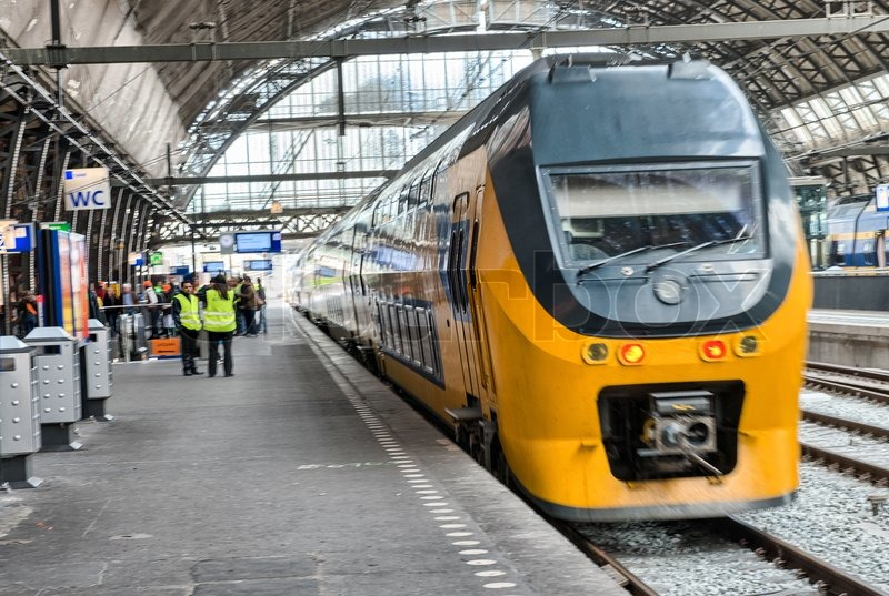 AMSTERDAM, APR 30: Train in central station, April 30, 2013 in Amsterdam. The station is used by 250,000 passengers a day, stock photo