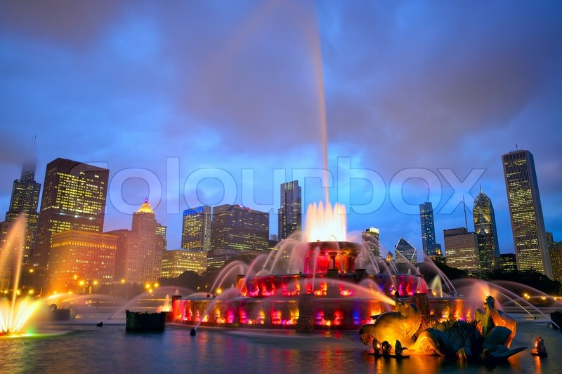 Chicago skyline with Buckingham fountain in Grant Park at night, USA, stock photo