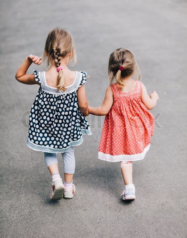 Two little girls are walking away | Stock Photo | Colourbox Best Friends Holding Hands Girls