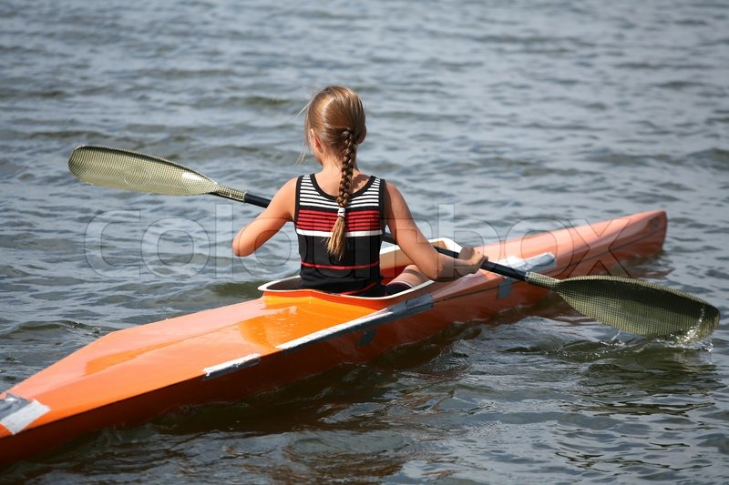 a lake in denmark with a blond girl on a kayak stock photo stock