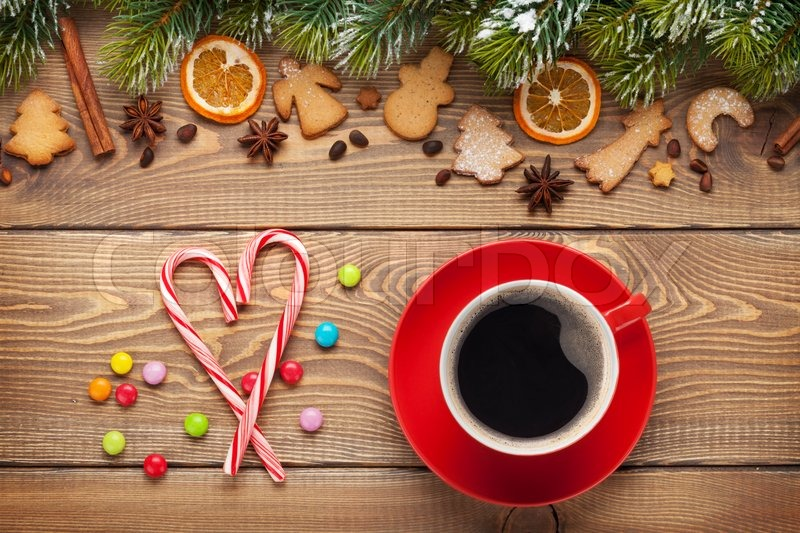 Coffee cup and christmas food decor on wooden table background, stock photo