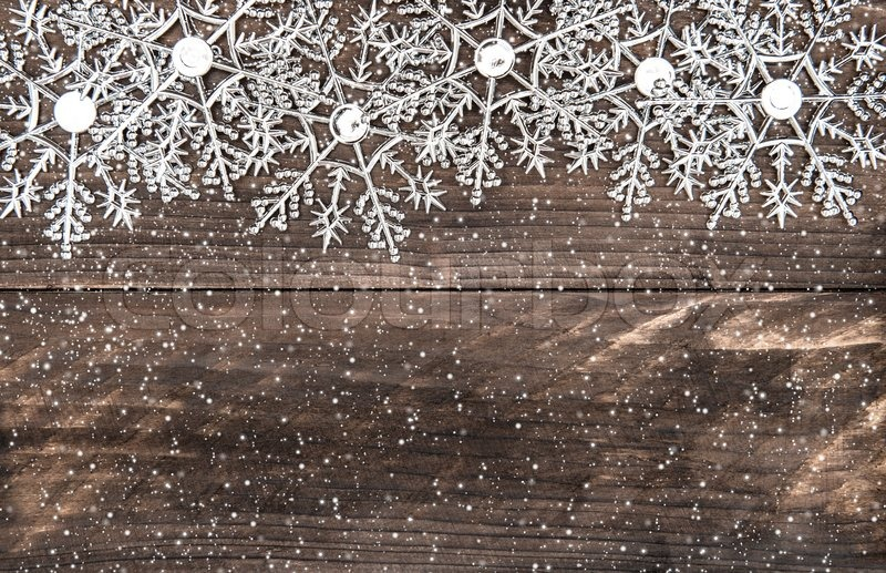 Christmas Decoration Snowflakes With Snowfall Effect Over Rustic Wooden Background Stock Photo