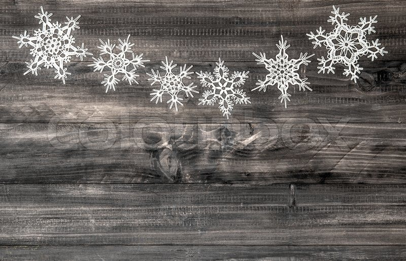 White Snowflakes On Rustic Wooden Background Christmas Decoration