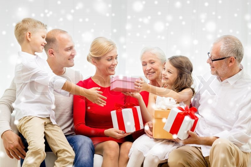 Family holidays generation christmas and people concept family holidays generation christmas and people concept smiling family giving each other presents at home stock photo negle Gallery