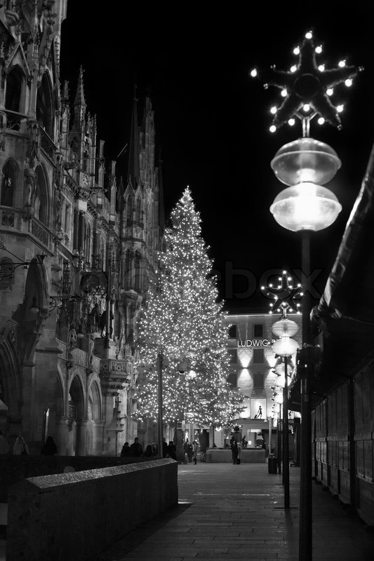 Christmas tree at night with lights. Marienplatz in Munich , Germany. (Black and White), stock photo