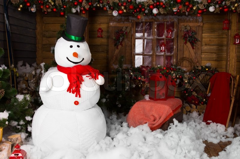 large indoor winter snowman on decorated wooden house with cotton snow on the floor stock photo colourbox