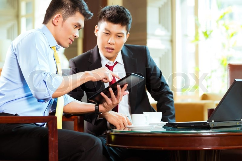 Two Asian Chinese Businessman Or Office People Having A