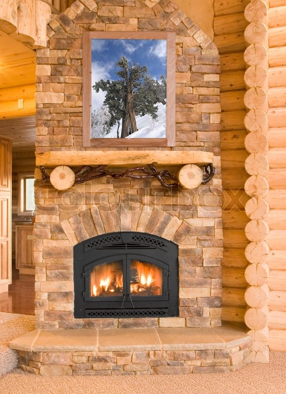Stock image of 'Log Cabin Home Interior with Warm Fireplace with wood, flames, ash, embers and charcoal'