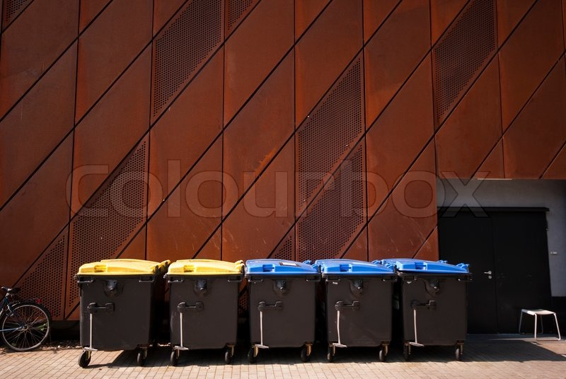 Rusty facade and garbage bins - Part of University Science Centre - Museum in Bremen, Germany, stock photo