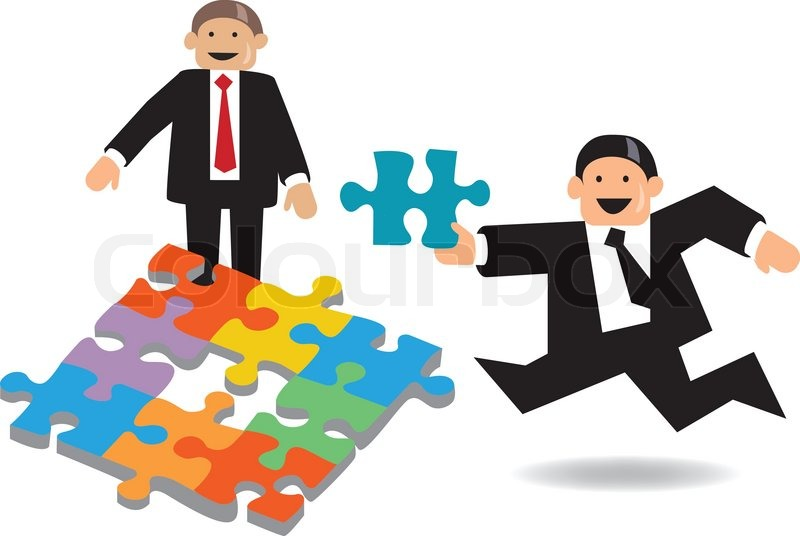 Business Men Busy Making Jigsaw Puzzle