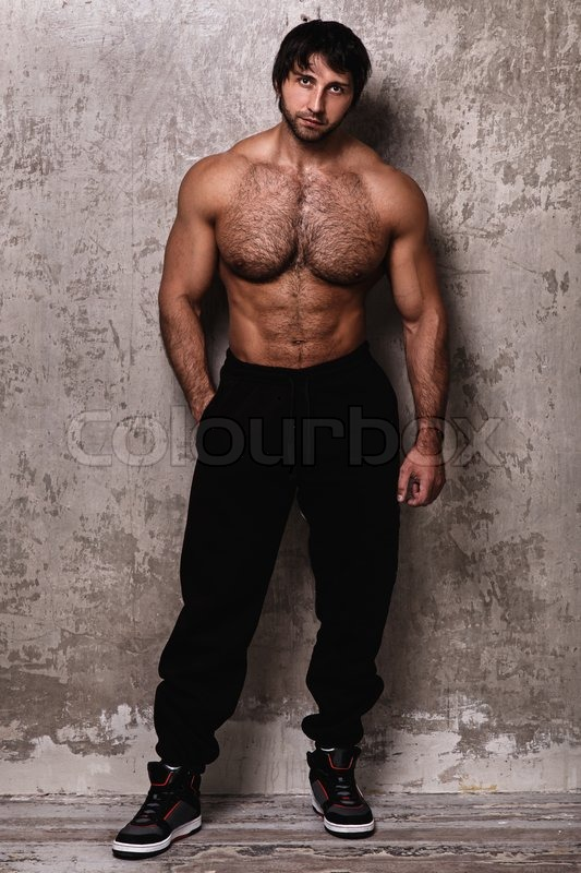Mature hairy male bodybuilder