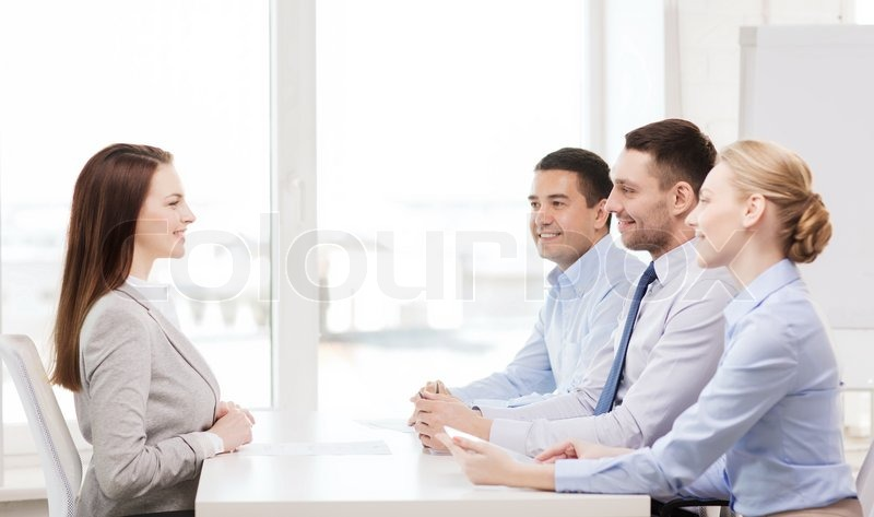 Business, career and office concept - smiling businesswoman at job interview in office, stock photo