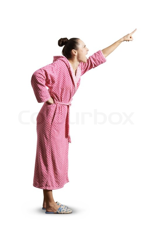 Angry screaming woman in pink dressing gown looking up and pointing ...
