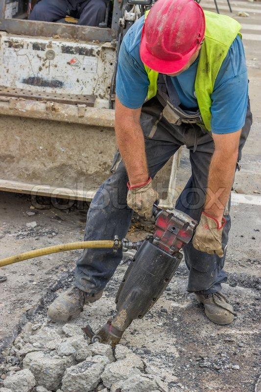 holes machine operator laborer jackhammer construction worker roadworks construction worker using a jackhammer stock photo