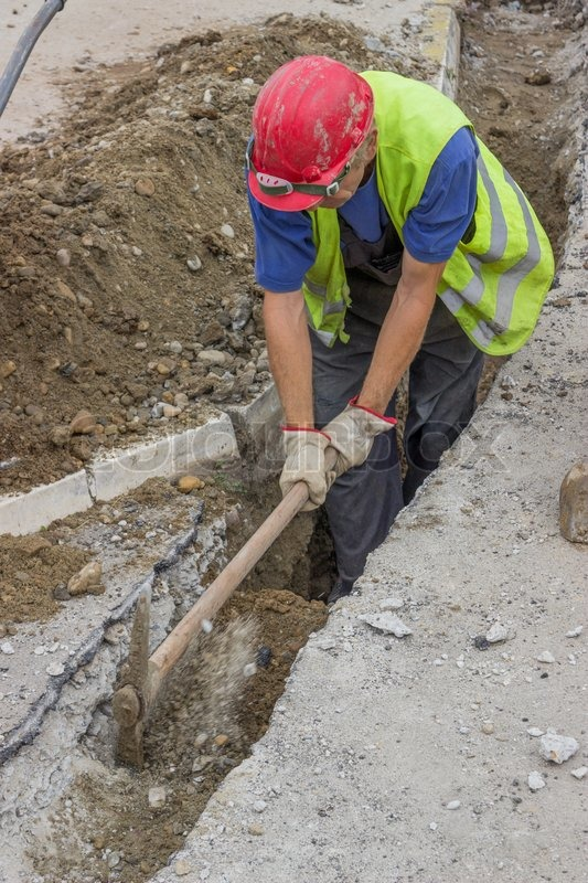 Use pickaxe to dig trench for a new     | Stock image | Colourbox