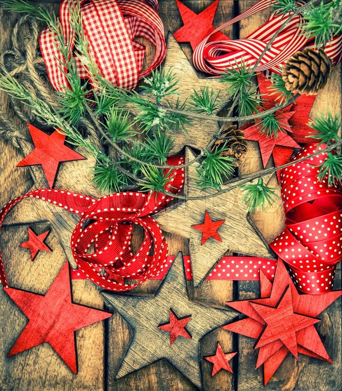 christmas decorations wooden stars and red ribbons nostalgic retro style toned picture dark designed image stock photo