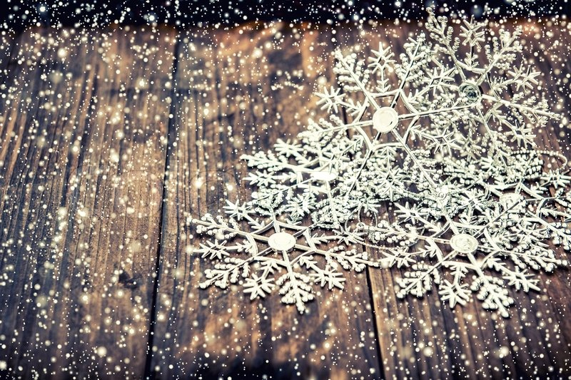 Christmas decoration snowflakes with falling snow effect over ...