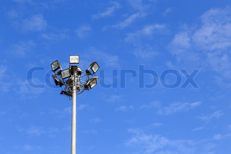 Spot light pole with blue sky in the park, stock photo