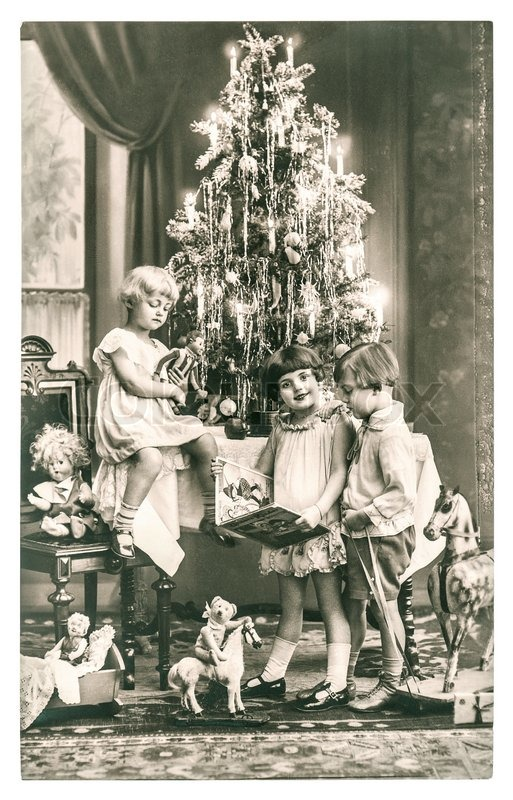 Happy kids with christmas tree gifts and vintage toys antique sepia picture with original film - Weihnachtsbaum antik ...