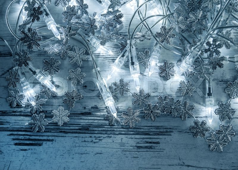 christmas lights decoration with silver snowflakes on wooden background stock photo colourbox - Silver Christmas Lights