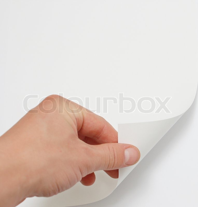 Hand turning page | Stock Photo | Colourbox