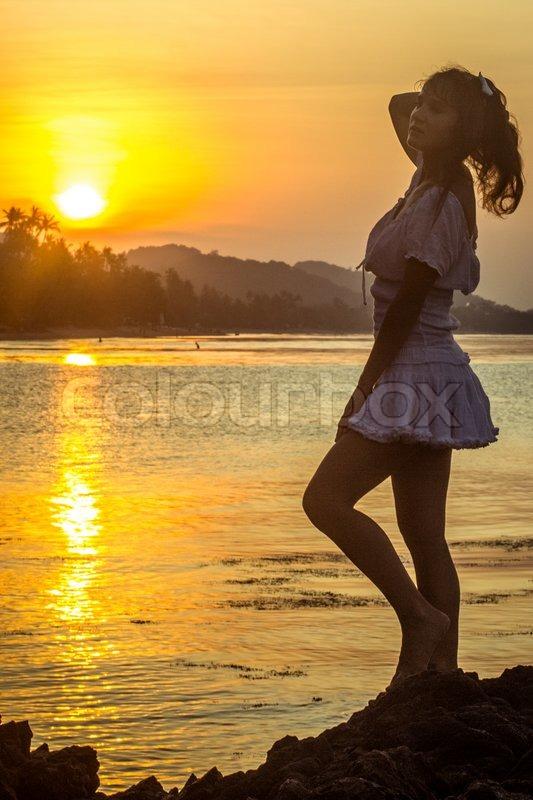 Girl silhouette on sunset beach background Koh Samui, stock photo
