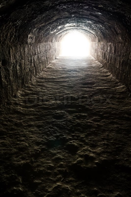 Light In The End Of The Dark Tunnel Stock Photo