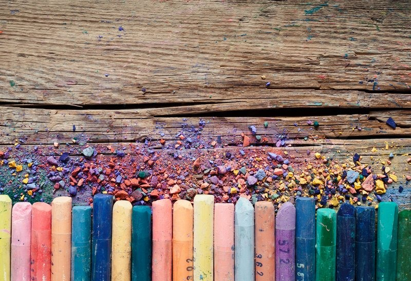 Pastel Crayons And Pigment Dust On Rustic Wooden Background