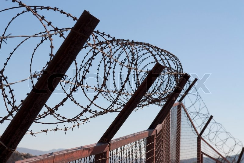 Security with a barbed wire fence photo. Protection concept design ...