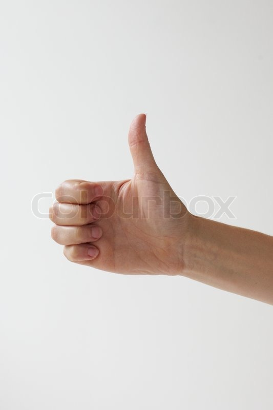 Stock image of 'Hand gesturing sign language - thumb's up'