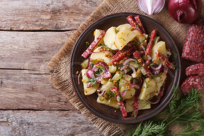 German Potato Salad On A Plate And Ingredients Close Up View From Above Horizontal Rustic Style