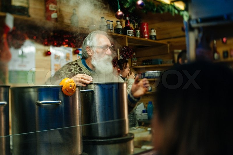 STRASBOURG, FRANCE - DEC 5, 2014: Selling mulled wine at Strasbourg Christmas Market. Strasbourg is considered the most picturesque experience of Christmas spirit and one of the oldest Christmas Market in Europe attracting over 2 million visitors every ye