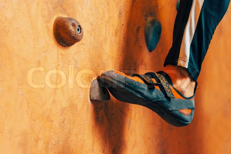 Close-up image of male foot on climbing wall, stock photo