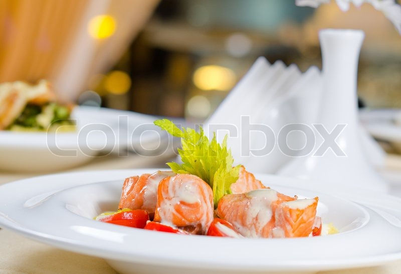 Close up of fish and cream dish on restaurant table for Fish dish menu