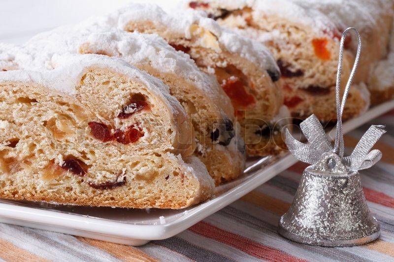 tasty german christmas fruit cake stollen closeup on a white plate horizontal stock photo colourbox