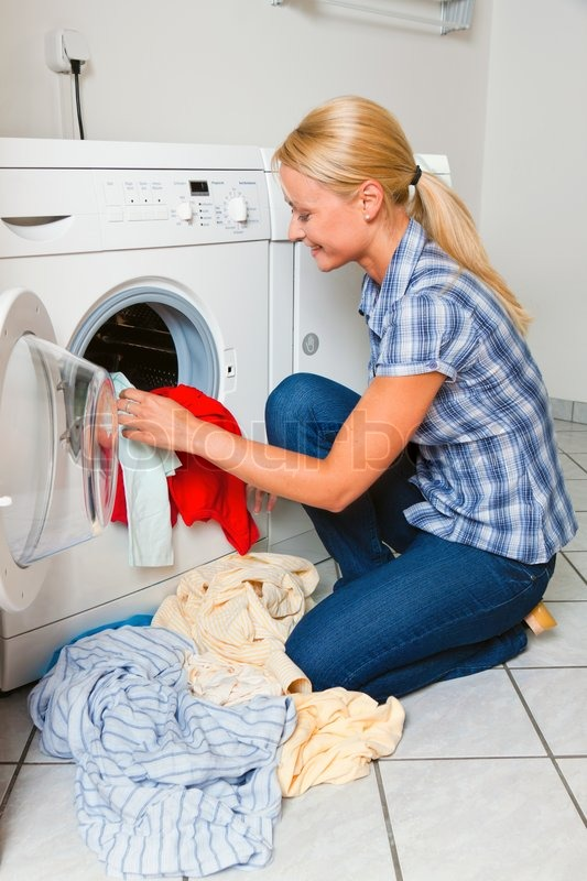 Clothes Washing Machine ~ A young housewife with washing machine and clothes