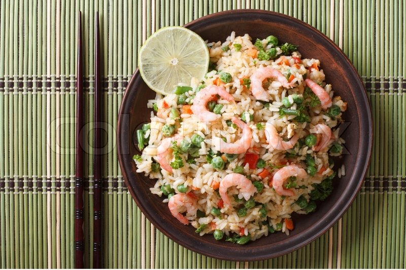 Japanese Fried Rice With Seafood And Vegetables On A Plate Close Up Horizontal View From Above