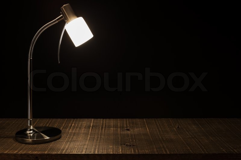 lamp shade on the table in a dark background stock