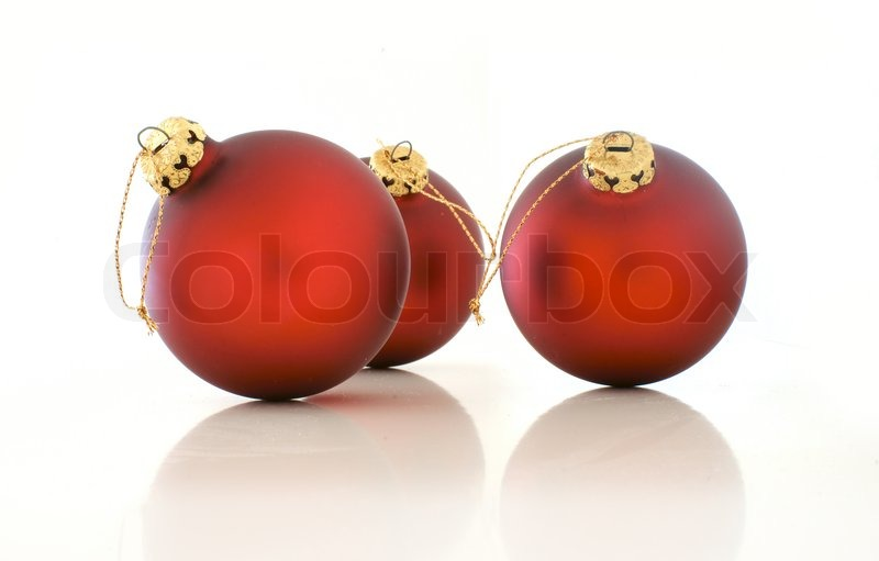 Stock image of 'Three red christmas balls on white background'