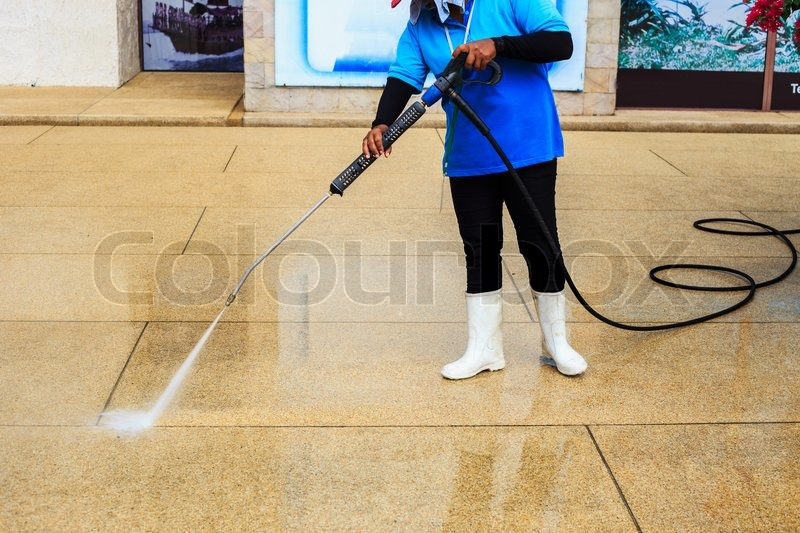 Floor cleaning with high pressure water jet, stock photo