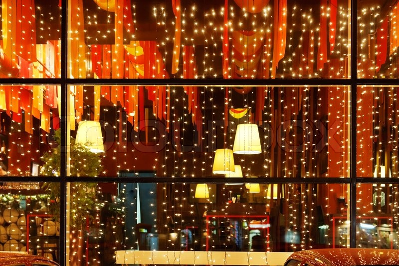 christmas decorative lights of restaurant window in night stock photo colourbox