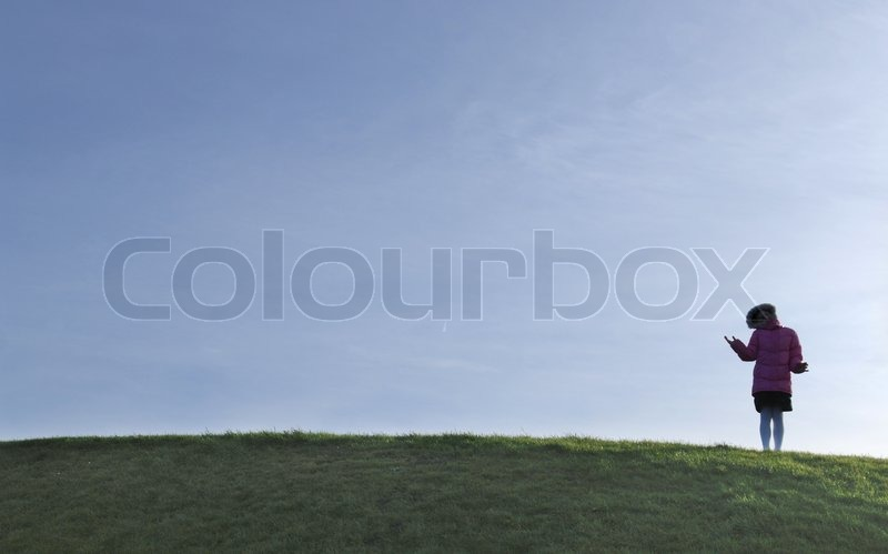 Person standing on landscape, stock photo